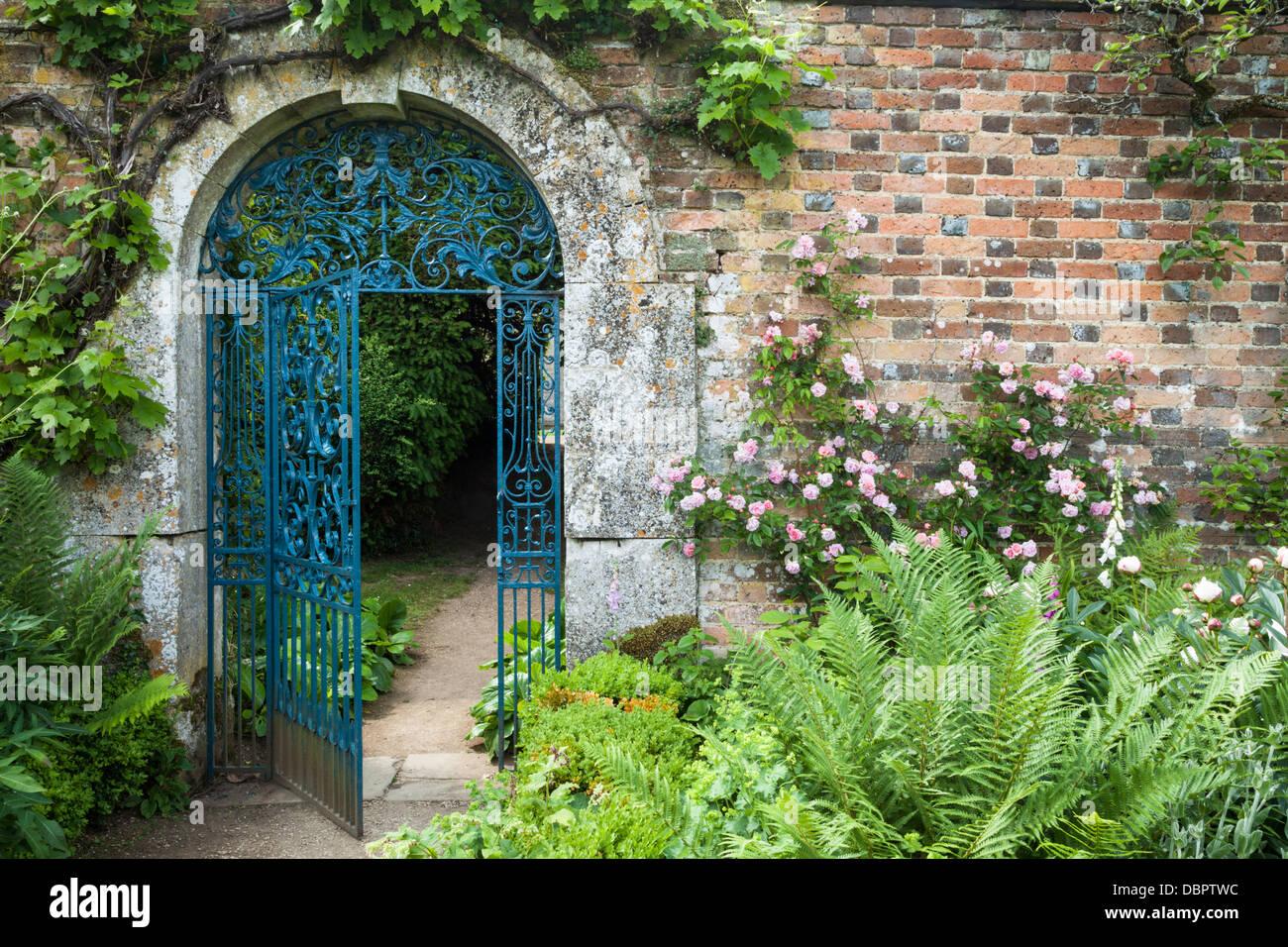 ornate wrought iron gate. ornate wroughtiron gate set within a cotswold stone arch and 17th century brick wall rousham house oxfordshire england wrought iron g