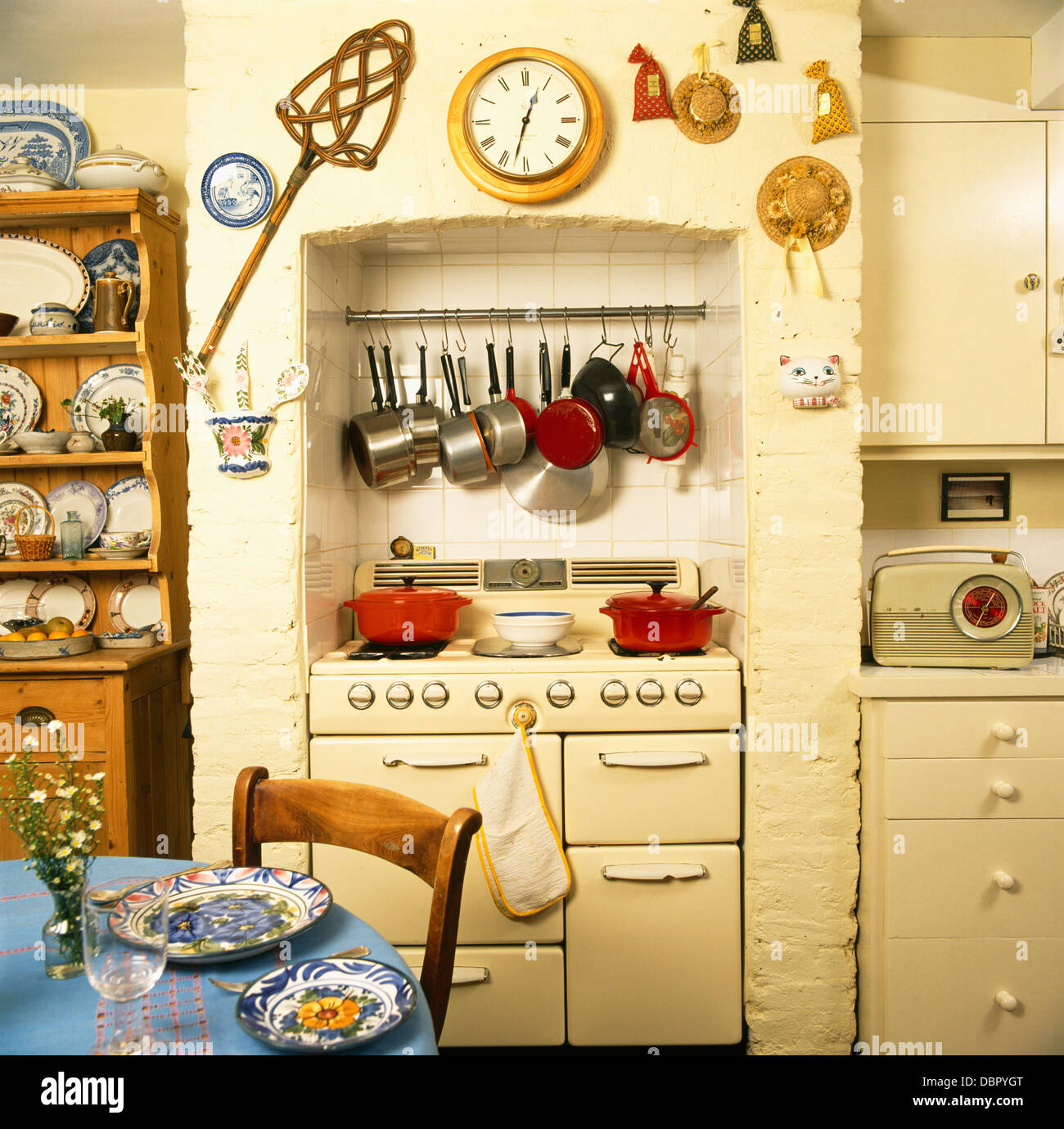 Old Fashioned Kitchen Pans On Rack Above Cream Range Oven In Old Fashioned Cream Kitchen