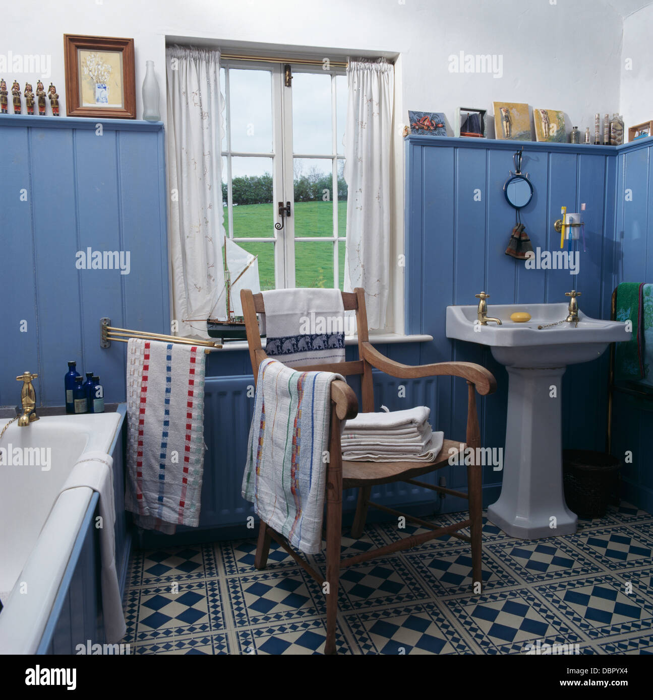 Blue cottage bathrooms - Blue Tongue Groove Paneled Walls And Blue White Tiled Floor In Cottage Bathroom With