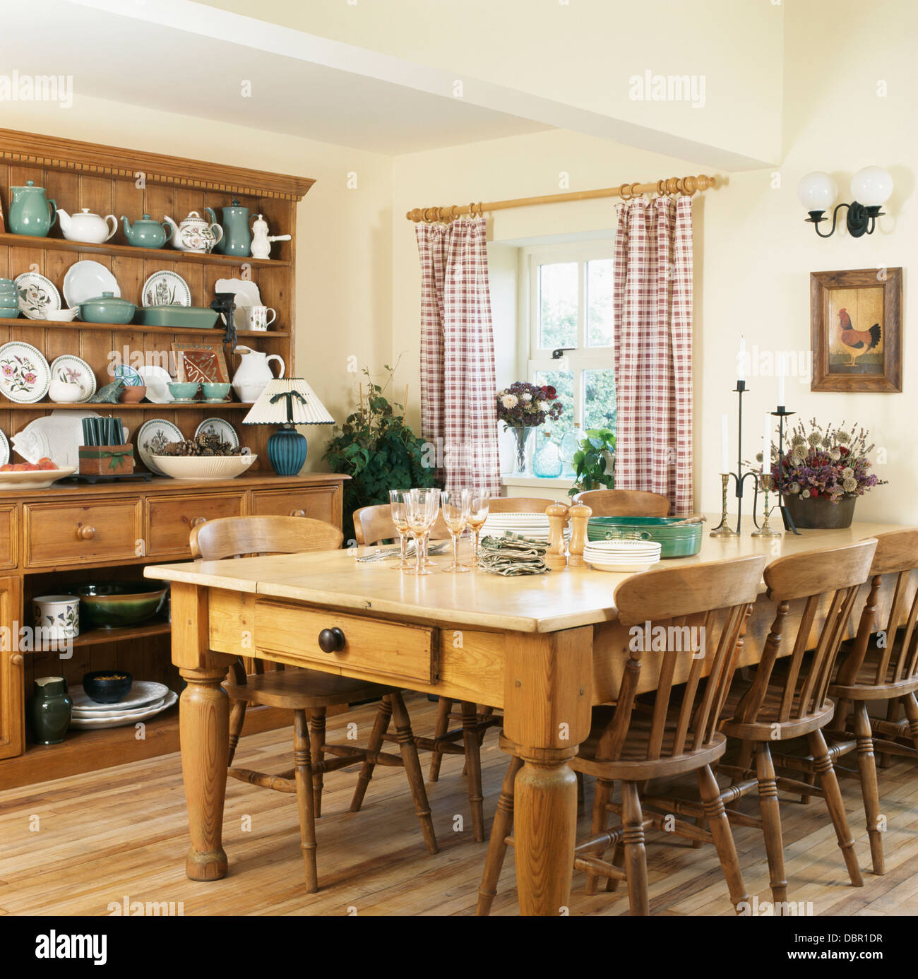 Pine Table And Chairs And Large Pine Dresser In Country Kitchen With Stock Photo Royalty Free