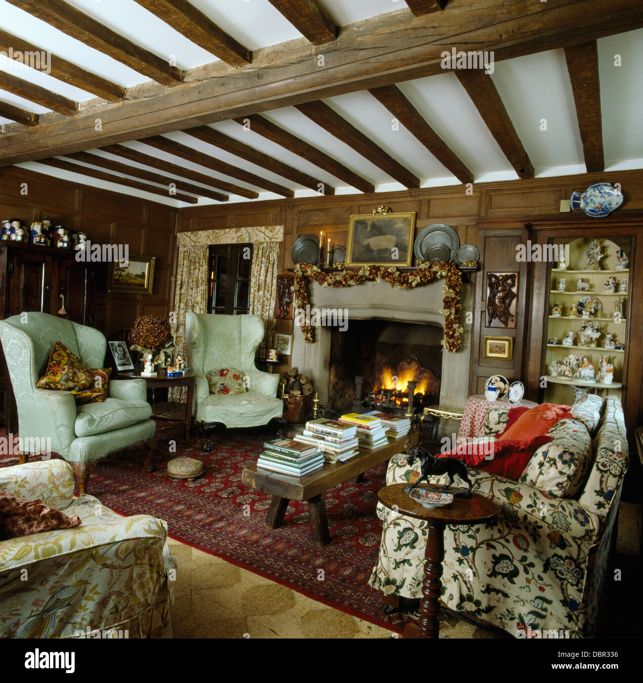 Comfortable wing chairs and floral sofa in beamed country - Floral country living room furniture ...