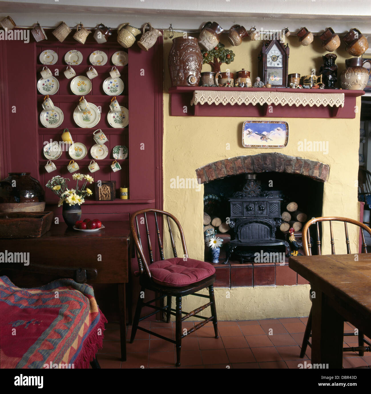 Collection of earthenware jugs and china plates on walls of dark ...