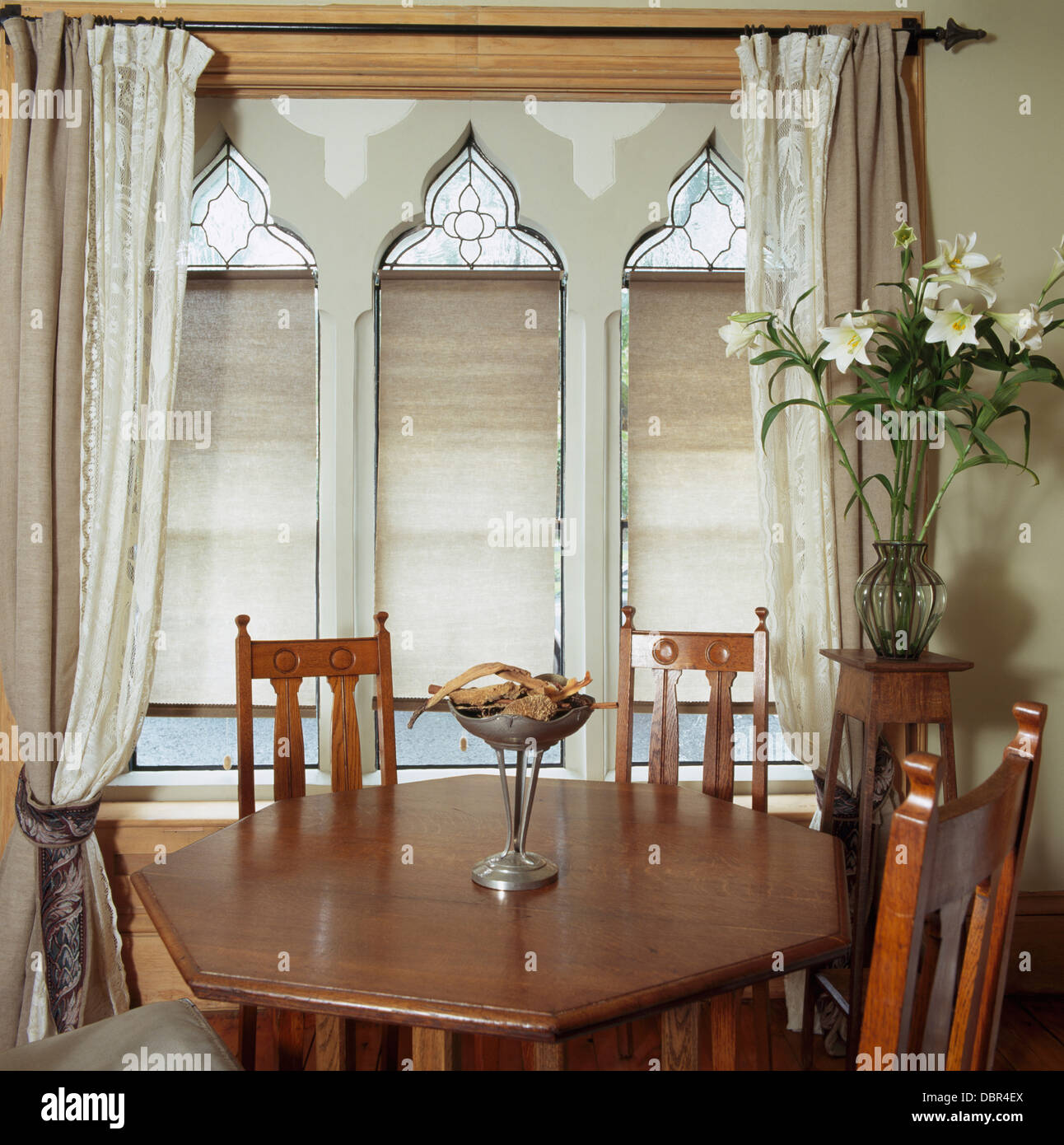 Arts Crafts Style Chairs And Table In Small Dining Room With Beige White Drapes On Gothic Window