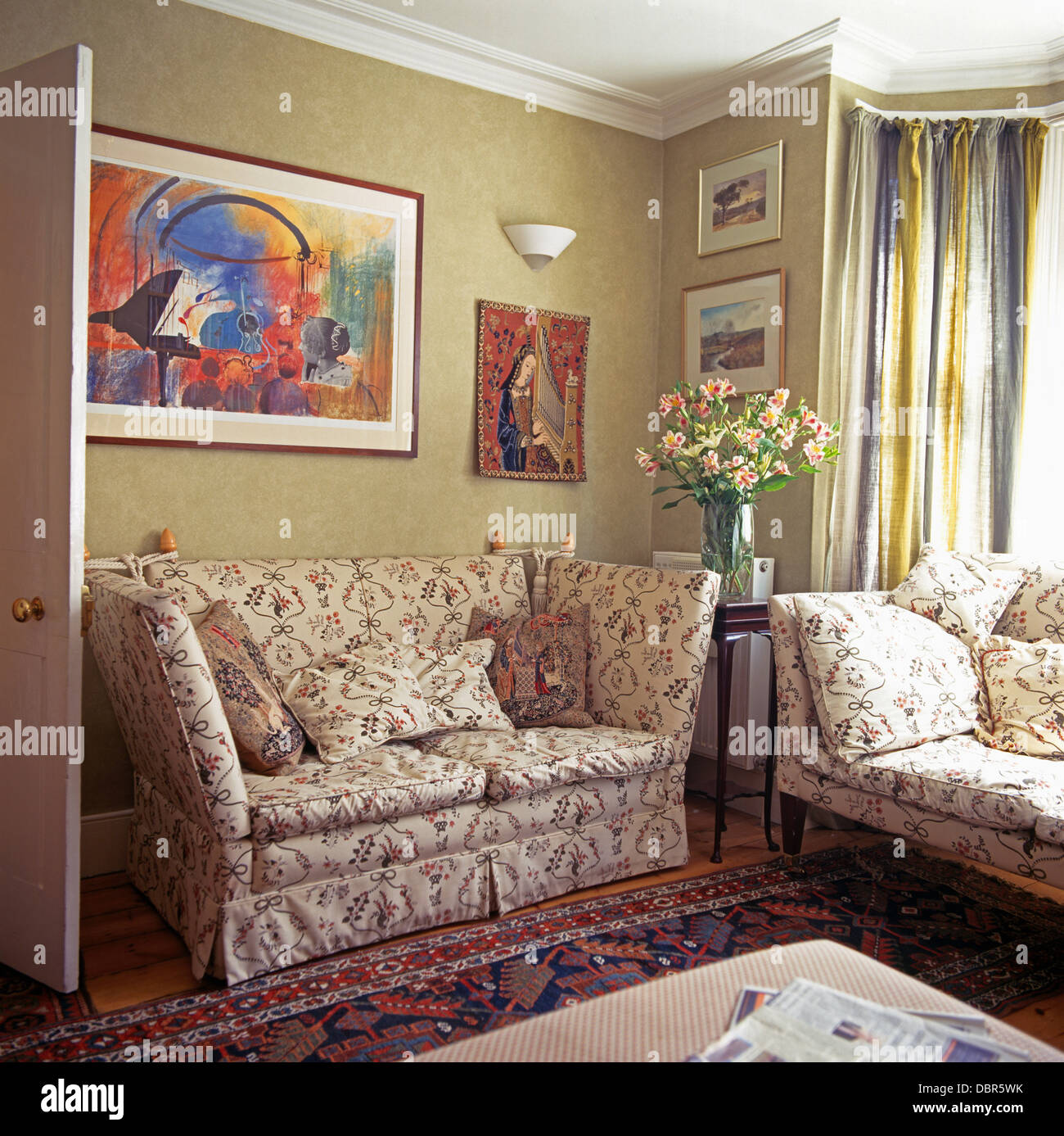 Colorful Abstract Painting Above Floral Knole Sofa In