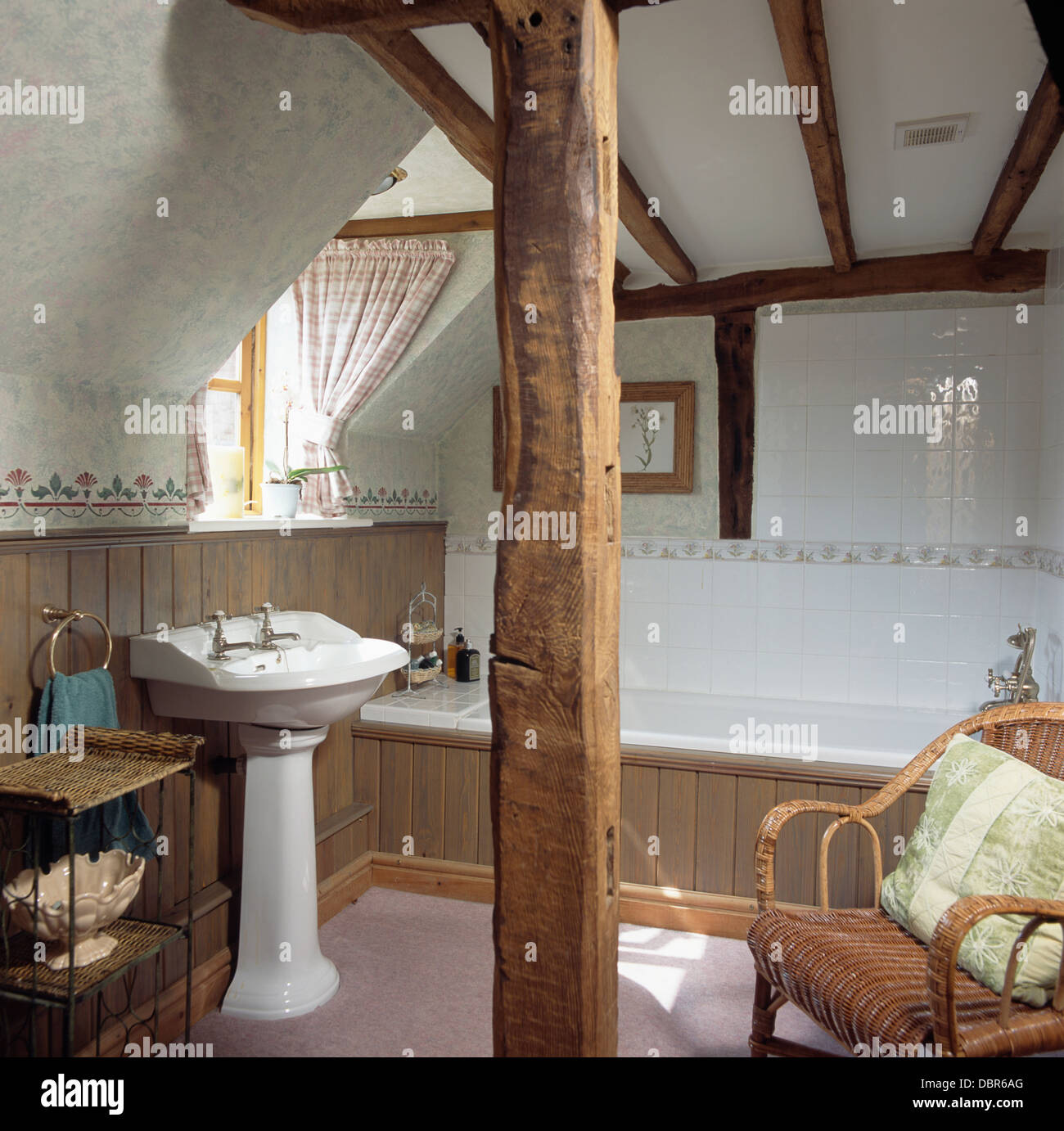 Vertical rustic wooden beam in attic bathroom with pedestal basin and stock photo royalty free - The rustic attic ...