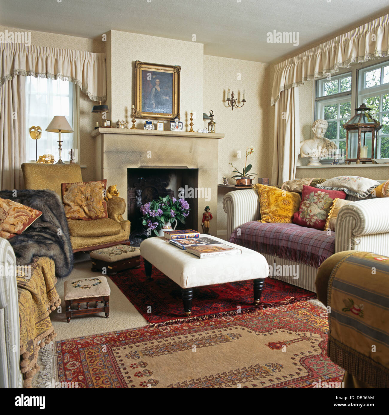 Sofas Piled With Cushions On Either Side Of Upholstered Stool In Front Of  Fireplace In Cottage Living Room With Oriental Rugs Part 59