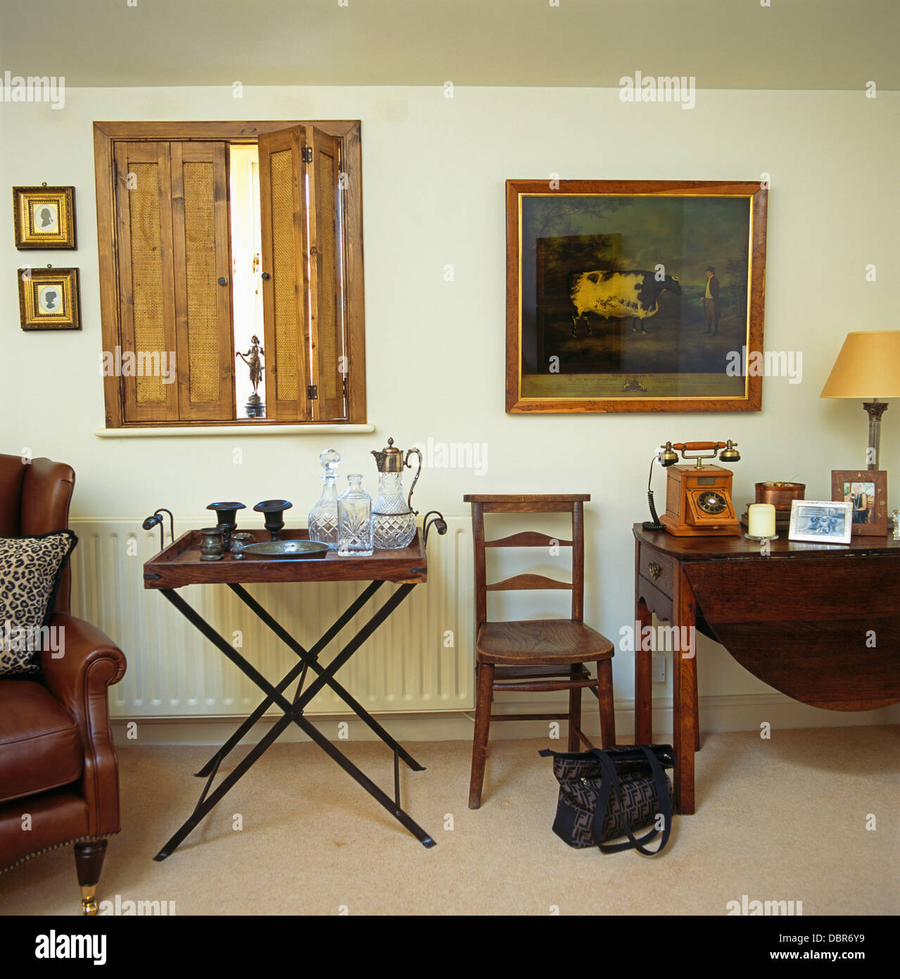 Superior Wooden Shutters Above Tray Table In Living Room With Ladder Back Chair And  Antique Table With Retro Telephone