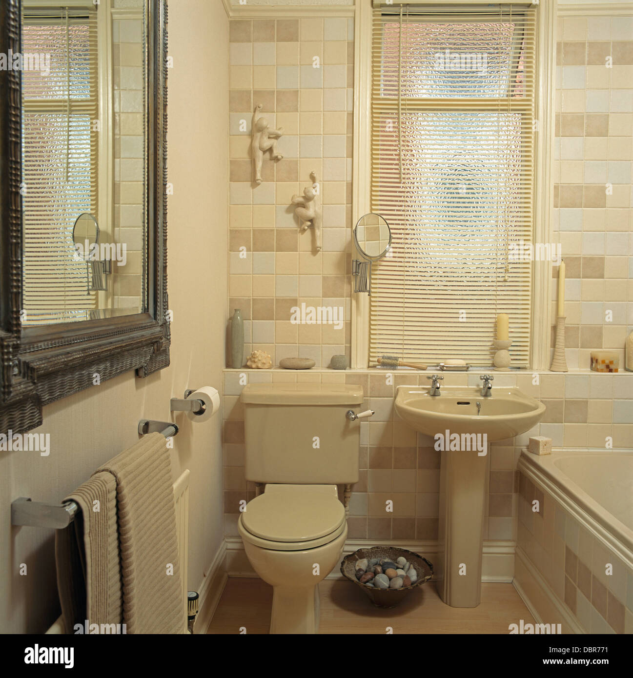 Bathroom Window Above Sink venetian blind on window above cream pedestal basin and toilet in