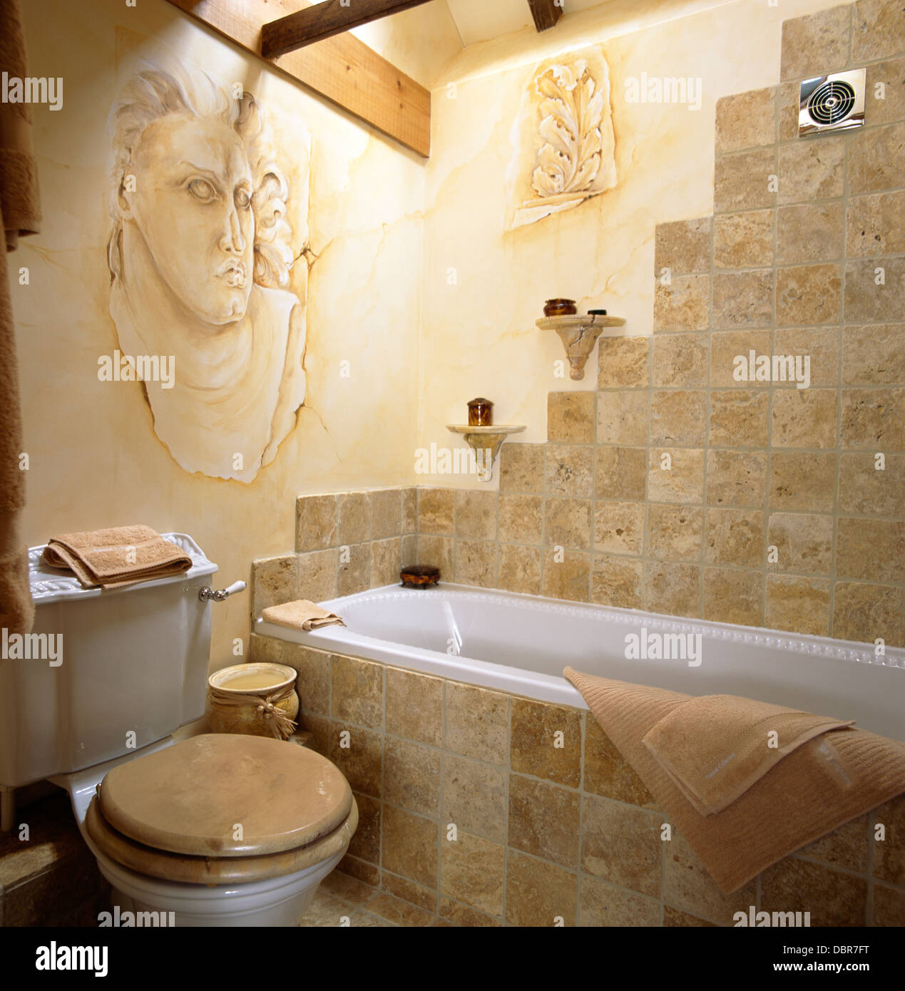 Stone tiled wall and bath surround in country bathroom with Stock ...