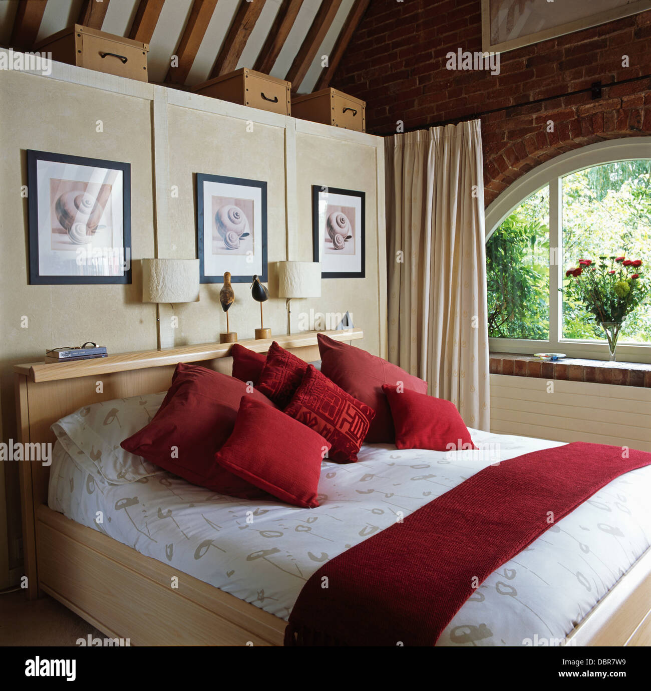Red velvet curtains in bedroom - Pale Wood Bed With Red Velvet Cushions And Throw In Country Bedroom With Cream Curtains On The Window