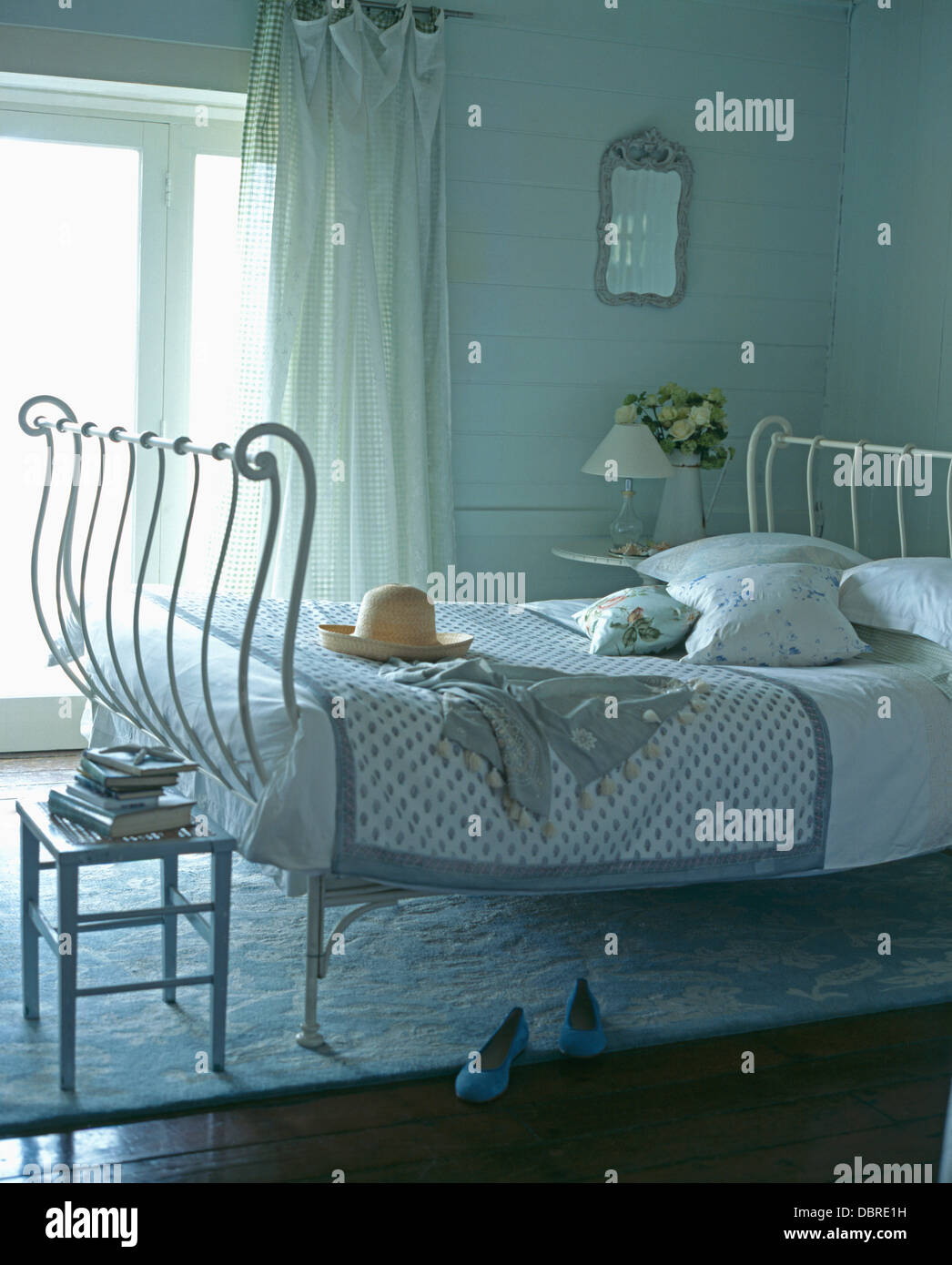 White Wrought Iron Bed With Pale Blue Quilt In Cottage Bedroom With Checked  And White