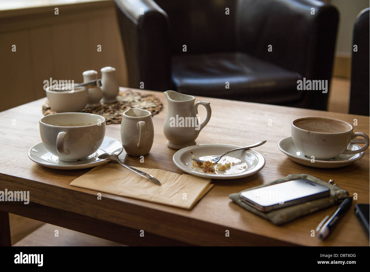 Coffee Shop Cups And Plates On A Table Stock Photo