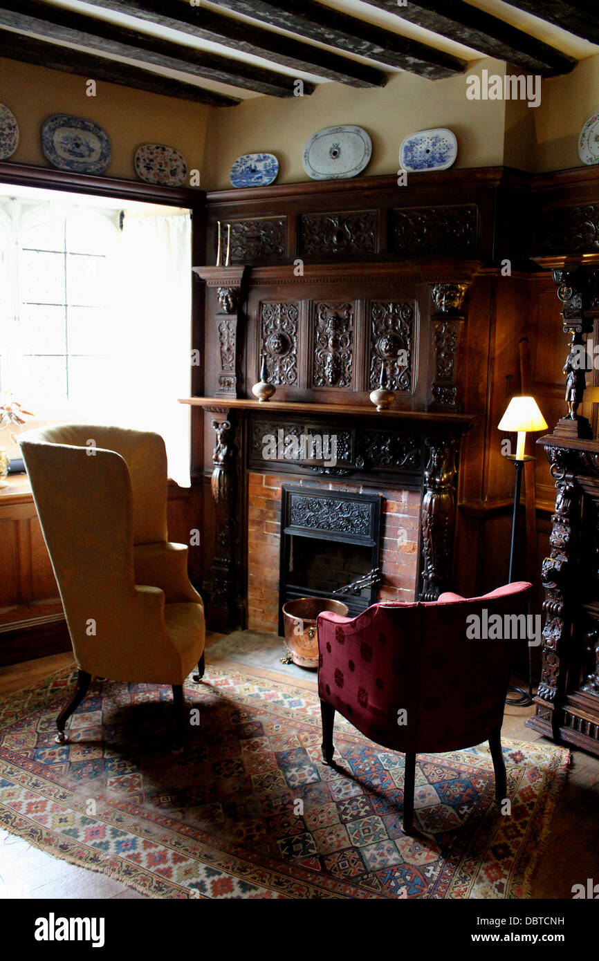 Interior Of An English Country House Next To A Fireplace With Two Chairs  And A Reading Lamp