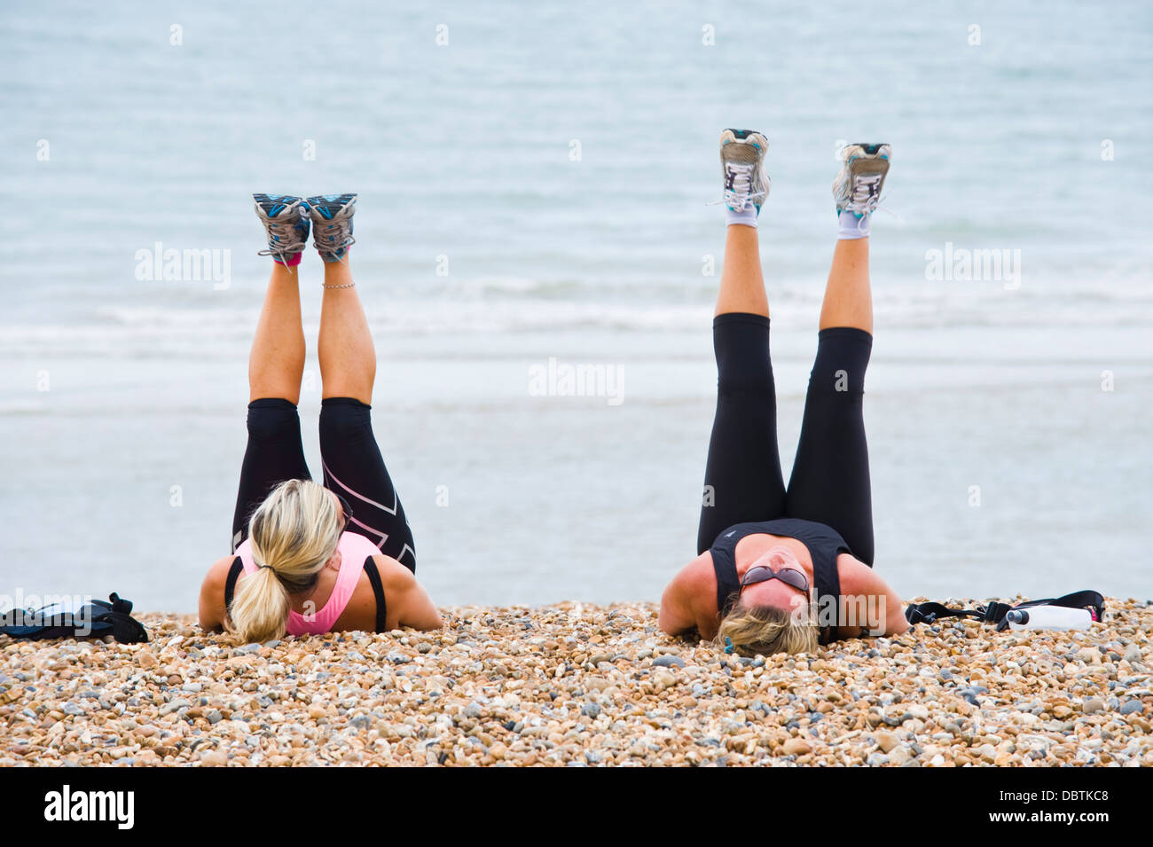 two mature women having an early morning fitness workout on the