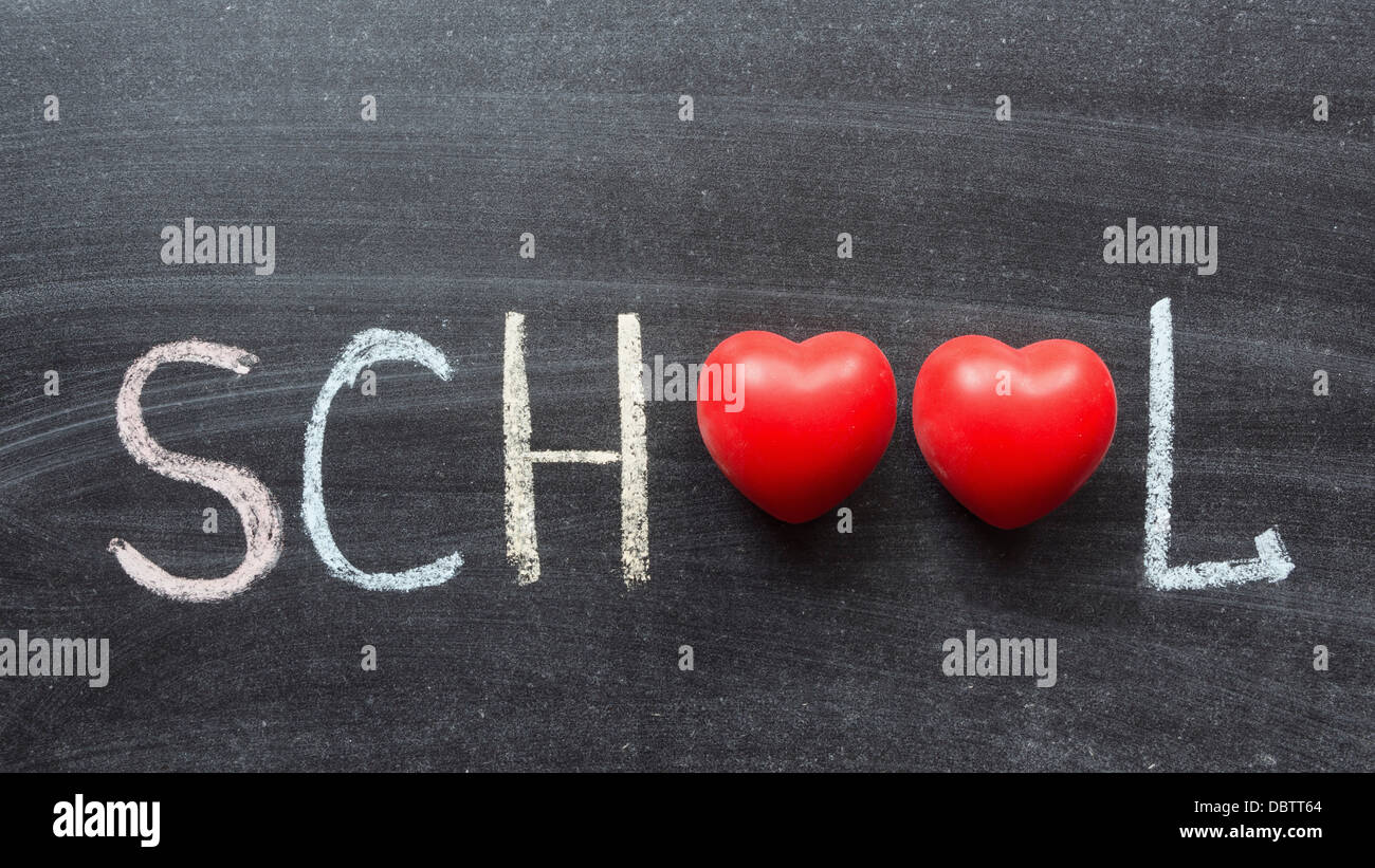 School word with two red hearts symbols handwritten on blackboard school word with two red hearts symbols handwritten on blackboard biocorpaavc