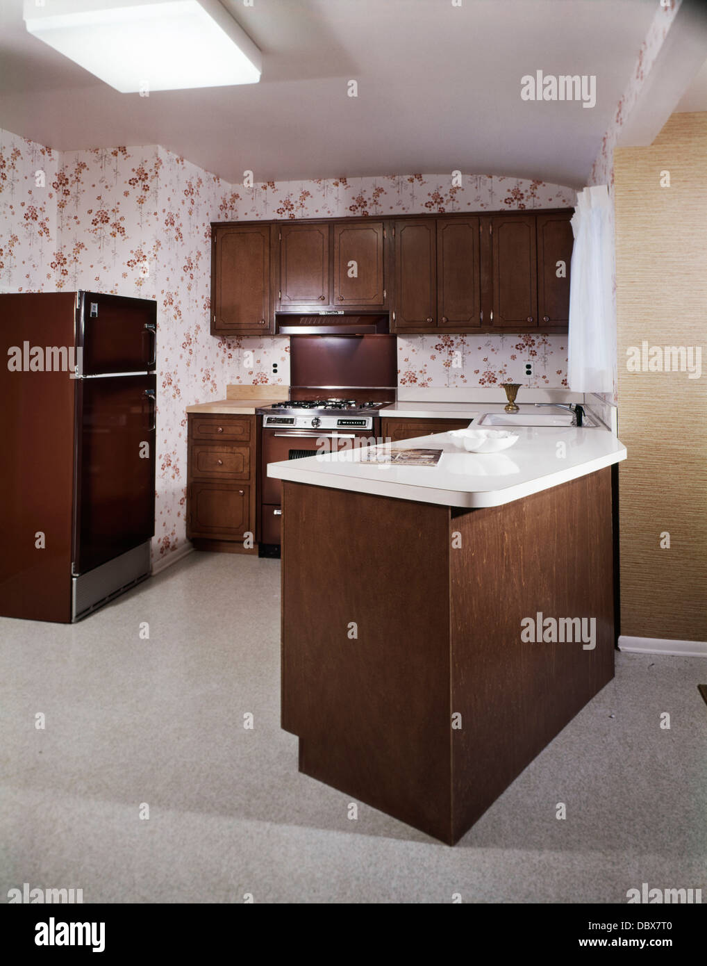1970 1970s retro kitchen with dining counter island dark wooden cabinets and appliances rust and white wallpaper 1970 1970s retro kitchen with dining counter island dark wooden      rh   alamy com