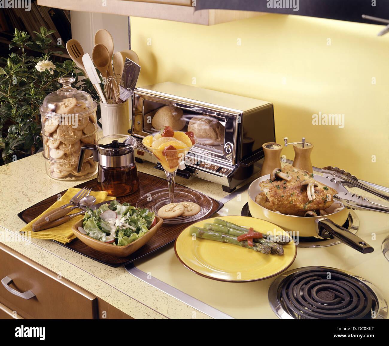 1960s 1970s meal prepared with kitchen appliances chicken potato salad asparagus tea fruit cocktail cookies 1960s 1970s meal prepared with kitchen appliances chicken potato      rh   alamy com