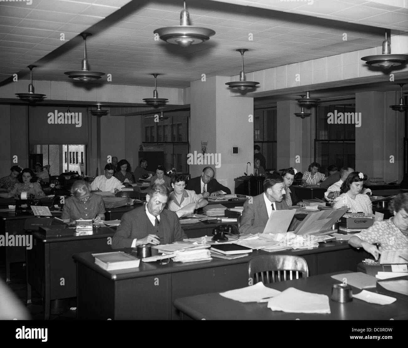 1940s interior business office men women desks accounting department stock photo royalty free for Department of interior jobs washington dc