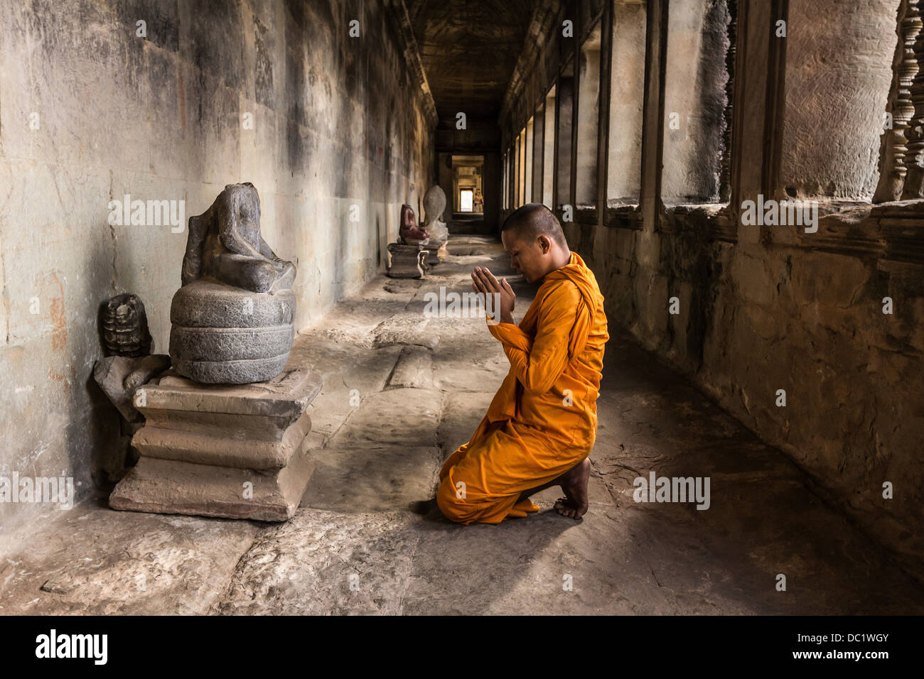 Young Buddhist monk praying in temple, Angkor Wat, Siem ...