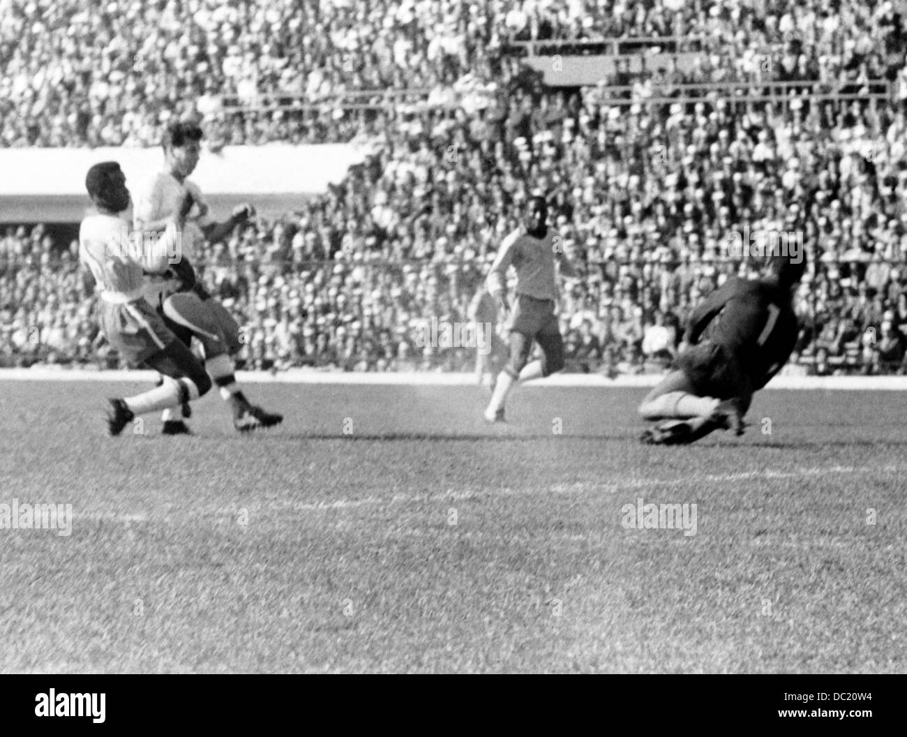 Josef Masopust of Czechoslovakia second left scores the only