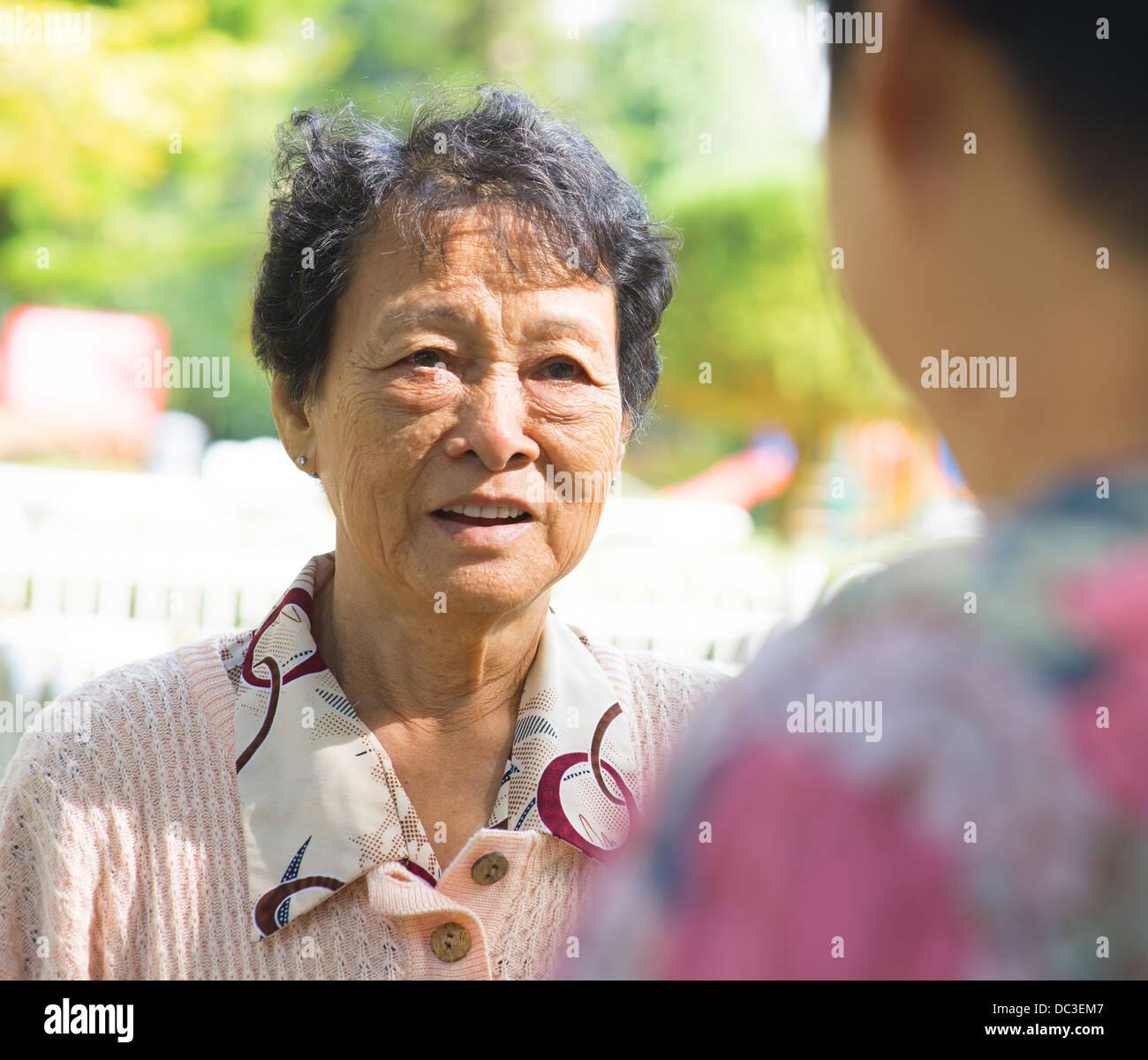Prime Asian 80S Senior Women Having Conversation At Outdoor Park Candid Hairstyles For Women Draintrainus