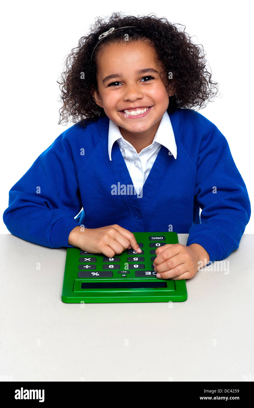 Uncategorized Kid Calculator african elementary school kid using a calculator stock photo calculator