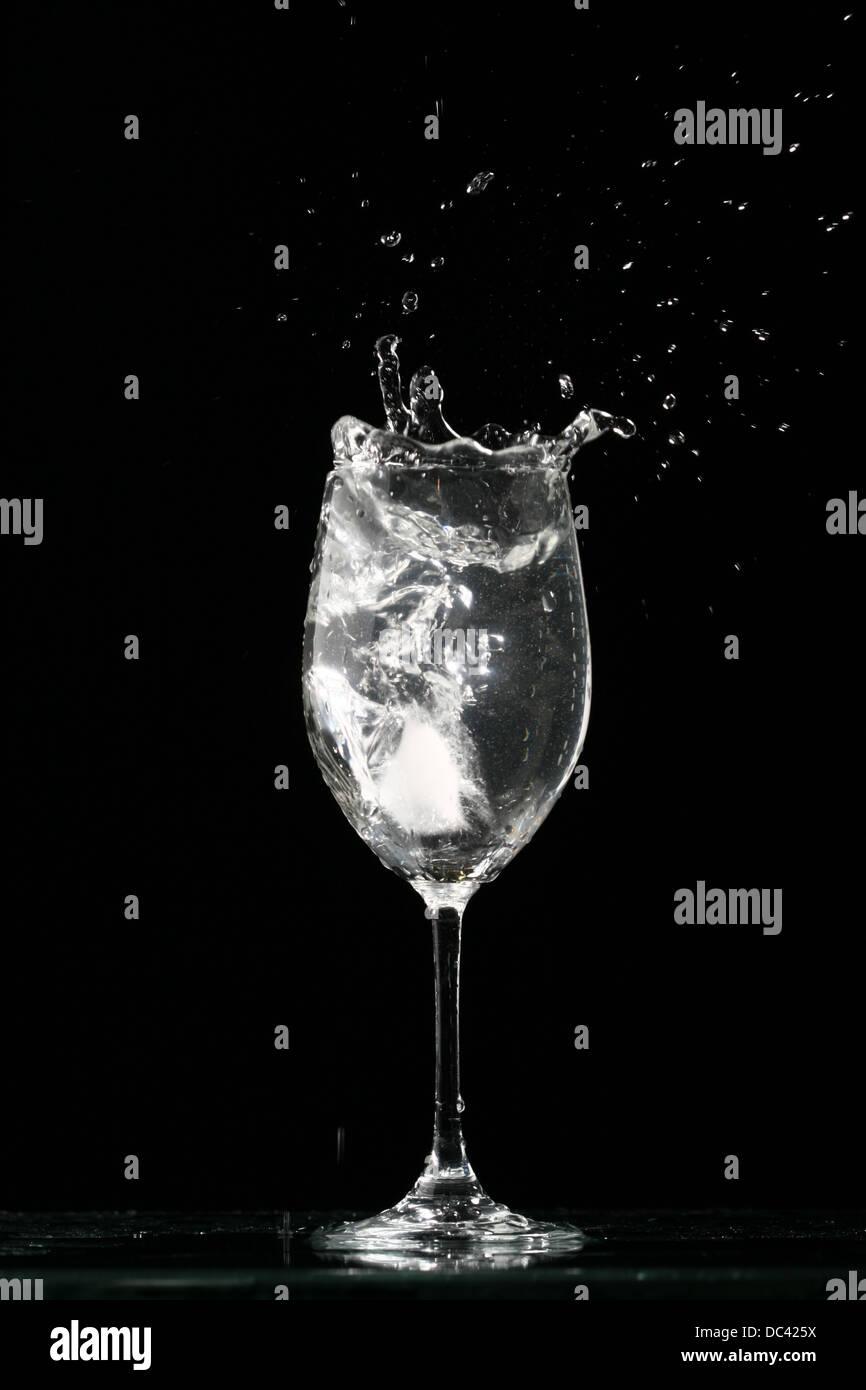 alcohol splash on black background stock photo royalty