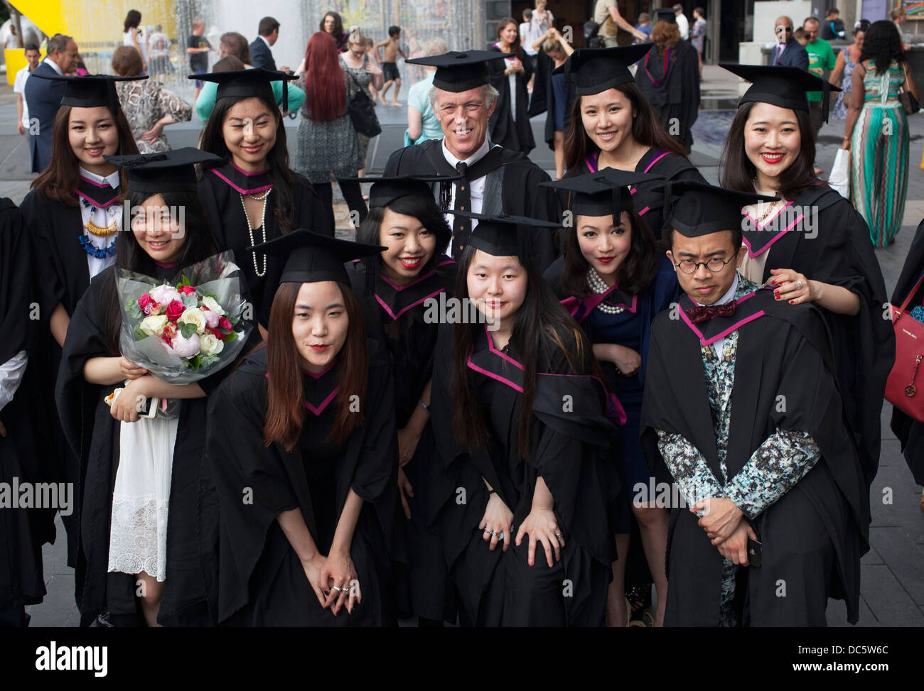 Asian students. Graduates from UAL wearing cap and gown celebrate ...