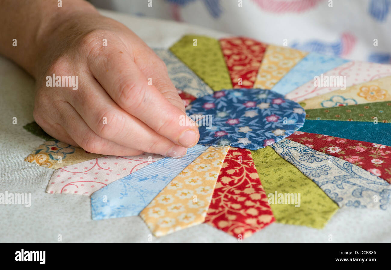 Woman's Hand Sewing Patchwork Quilt Stock Photo, Royalty Free ... : patchwork quilt by hand - Adamdwight.com