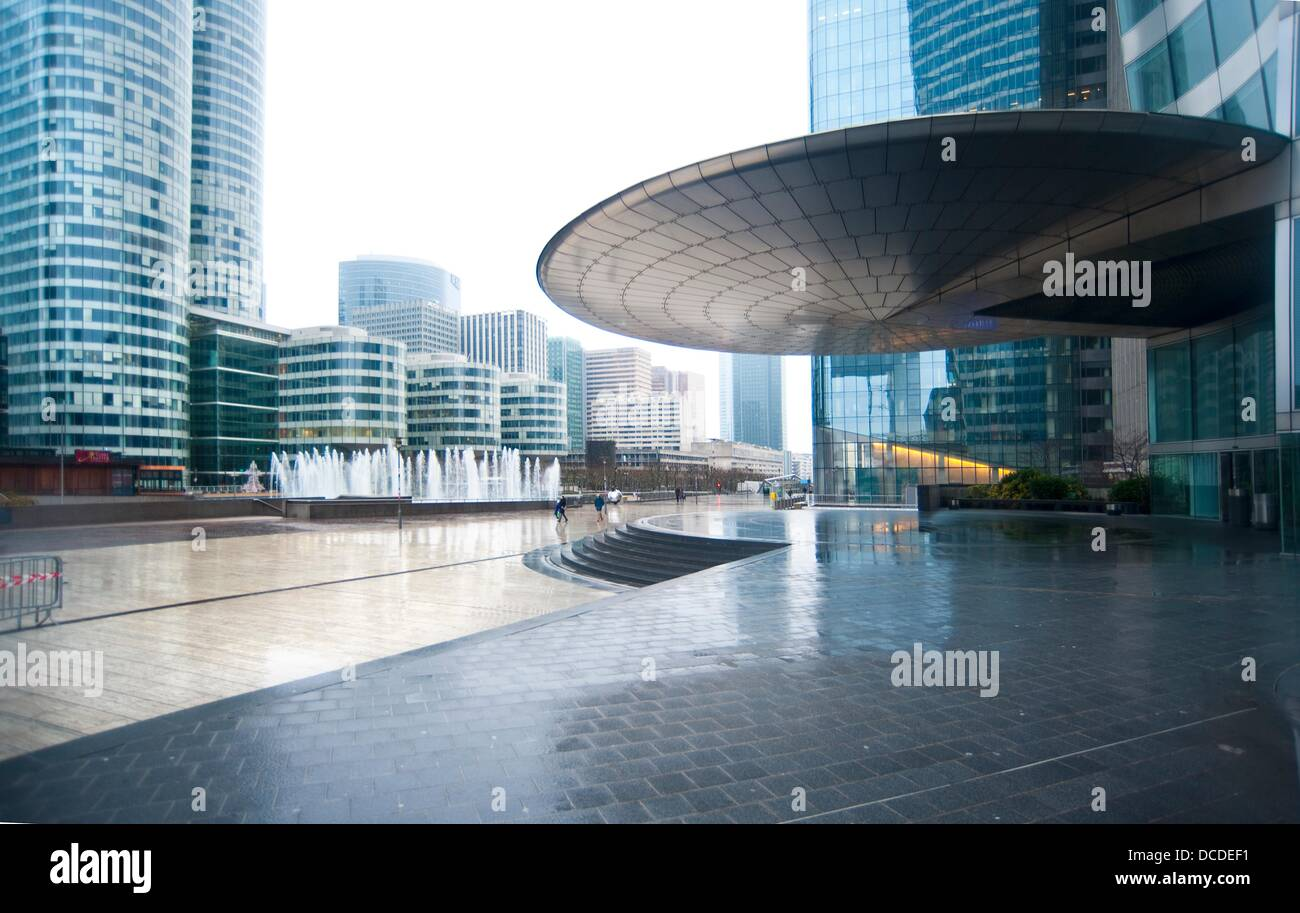 Entrance canopy of EDF tower and Coeur Defense building on the left La Defense business district under the rain Paris France & Entrance canopy of EDF tower and Coeur Defense building on the ...