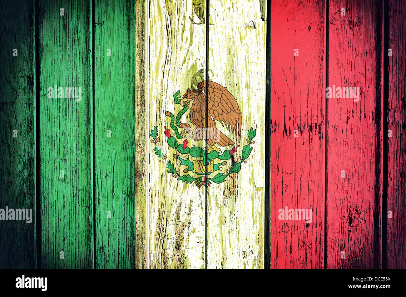 official mexican flag on the wooden background stock photo