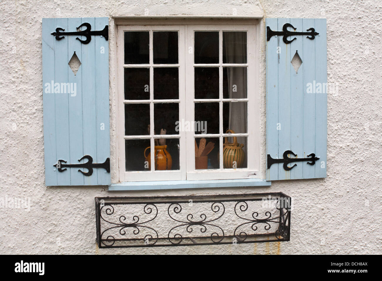 Pots In Window With Light Blue Shutters And Wrought Iron Window Box At Lyme  Regis In