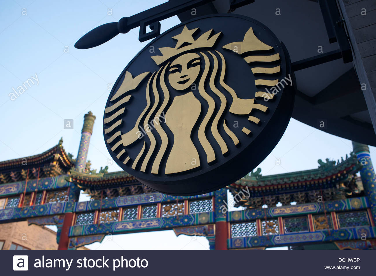 Starbucks logo stock photos starbucks logo stock images alamy starbucks logo is in front of a chinese traditional decorated archway at qianmen street in beijing biocorpaavc Image collections