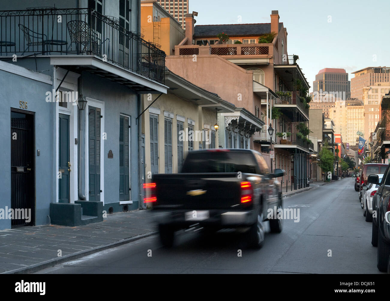 Pick up truck driving through the French Quarter of New Orleans ...