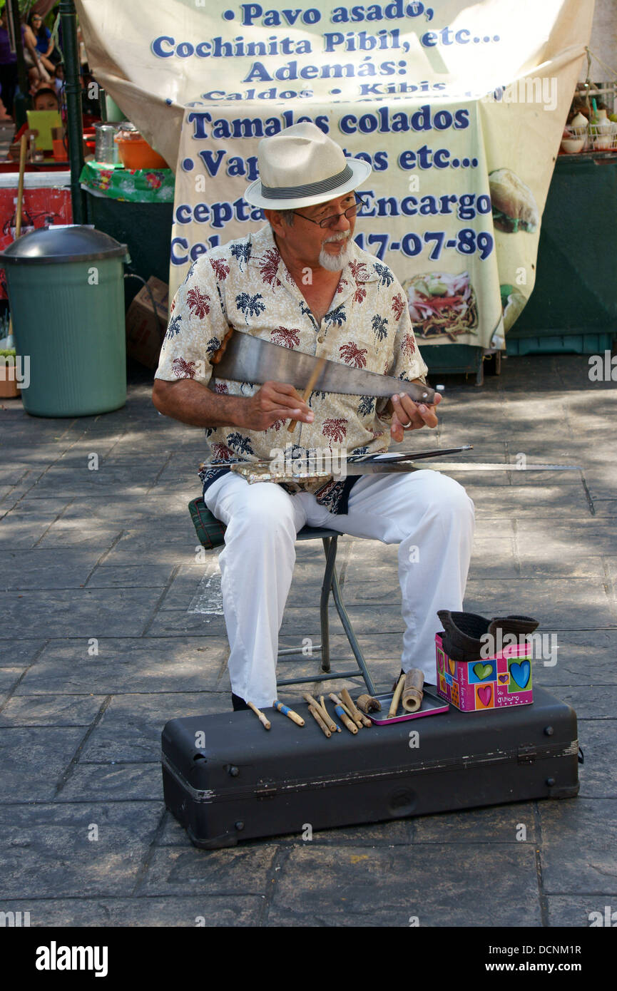 older-street-musician-playing-a-musical-