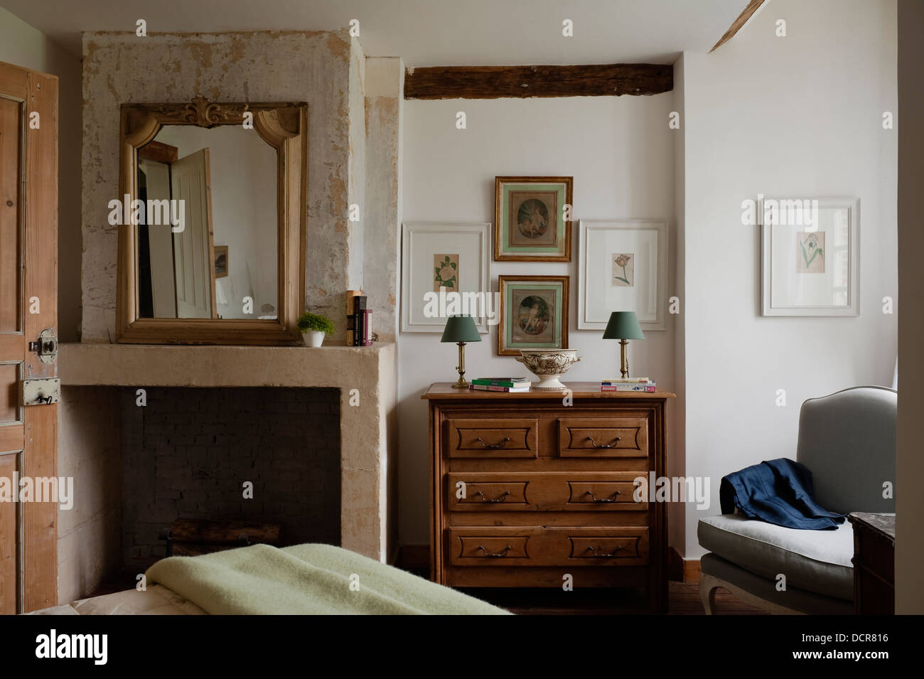Open Stone Fireplace Open Stone Fireplace In Bedroom With Wooden Chest Of Drawers Stock