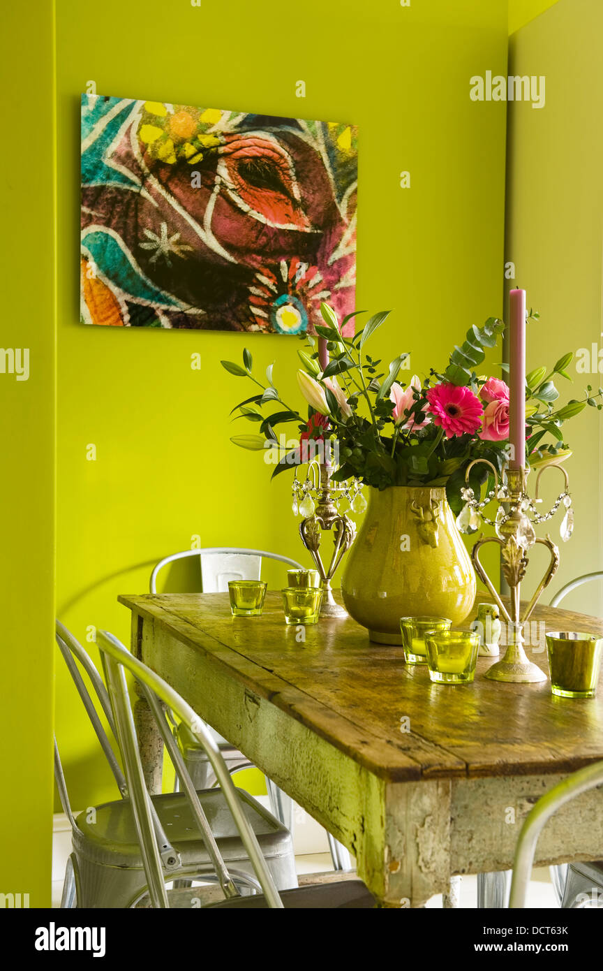 kitchen table with bold lime green painted walls stock photo