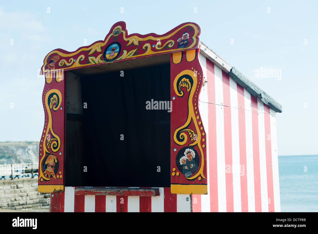 Red and White striped Punch and Judy booth ready for next show on the beach at Swanage & Red and White striped Punch and Judy booth ready for next show on ...