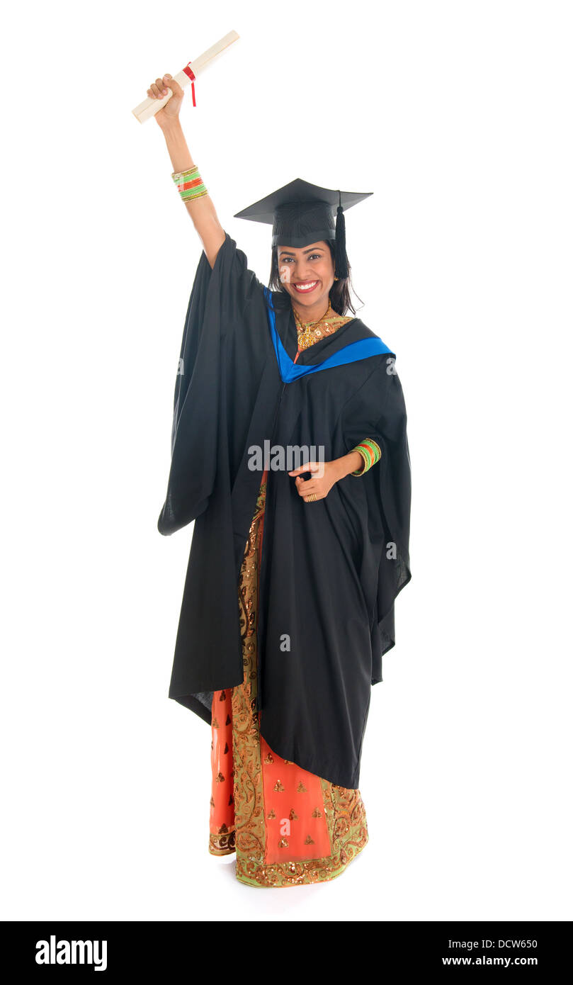Full length happy Indian university student in graduation gown and ...