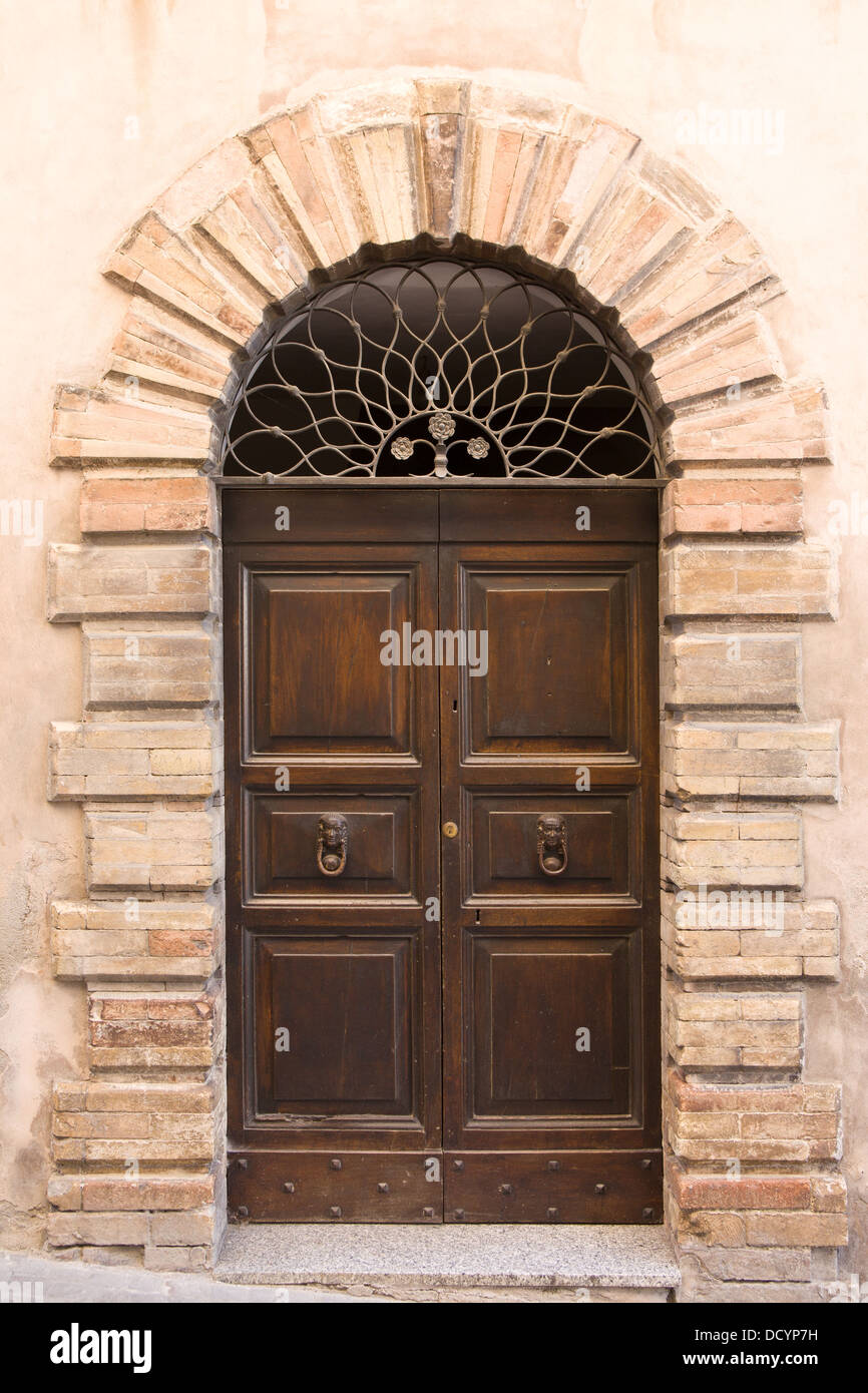 Stock Photo - View of old double wooden arched door of stone medieval palace with decorative wrought iron grille above door Montefalco Umbr & View of old double wooden arched door of stone medieval palace ... Pezcame.Com