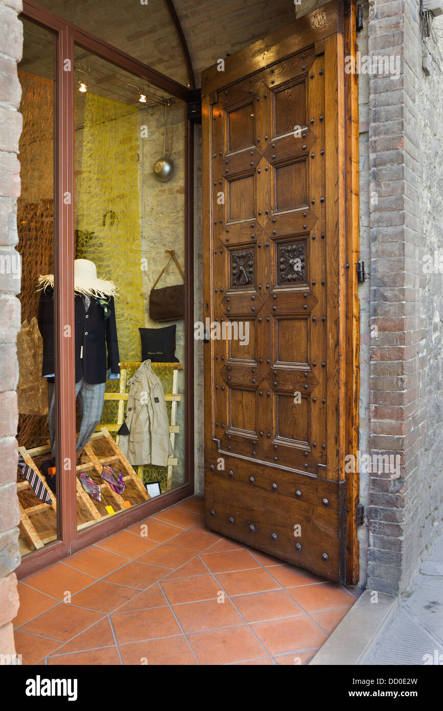 Detail of entranceway to clothing shop with imposing wooden door ...