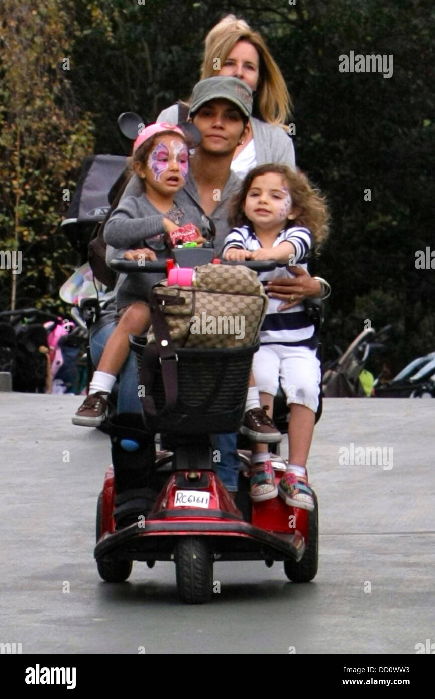 Halle berry zips around disneyland on a mobility scooter for Motorized scooter rental disneyland