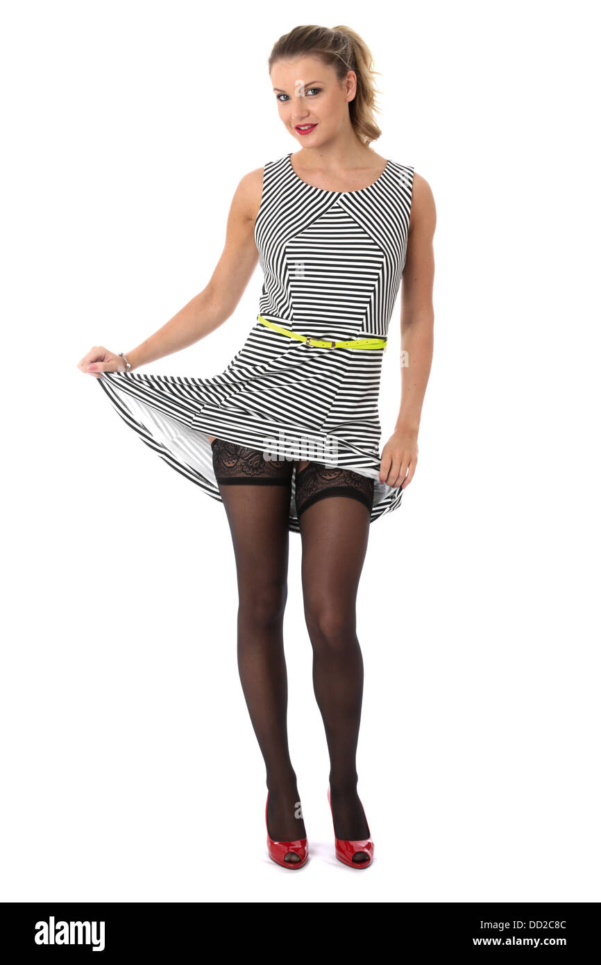 Model Released. Sexy Young Woman Raising Skirt Showing Stocking ...