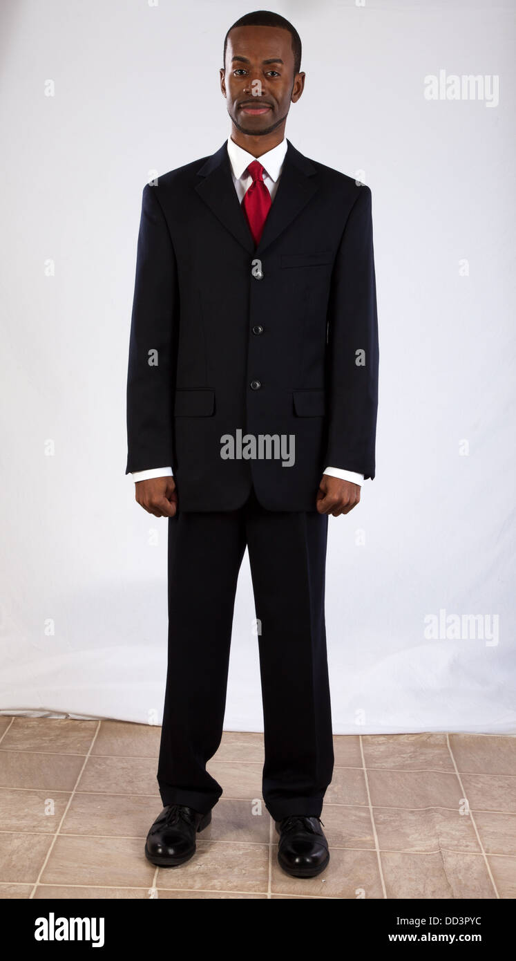 Handsome black man in a suit and red tie, looking at the camera ...