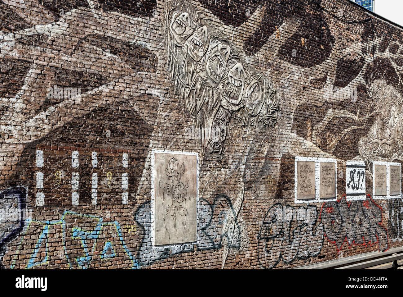 Brick Wall Art art work, quotations and graffiti on a brick wall at the db stock