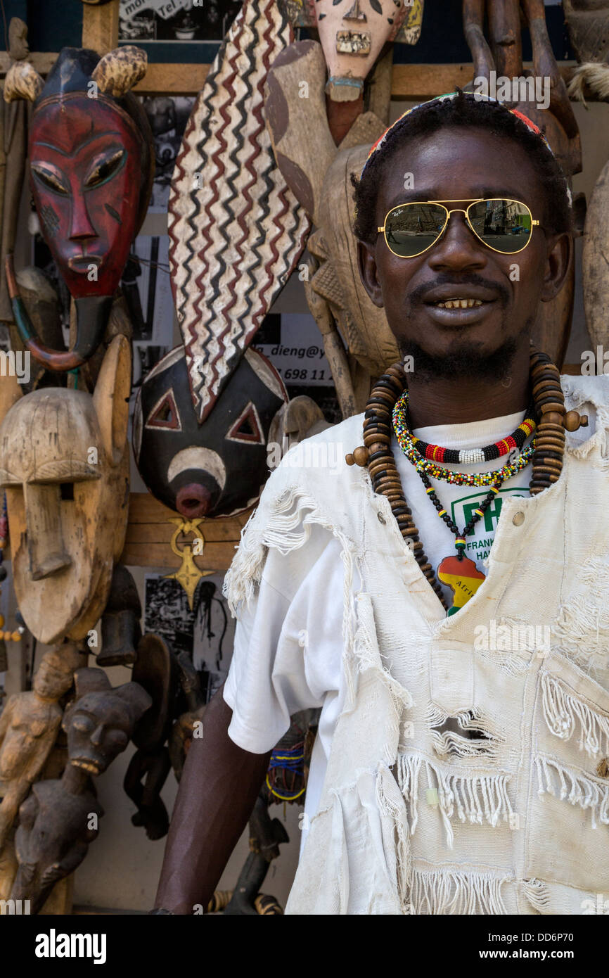 vendor of carved african masks for sale as souvenirs
