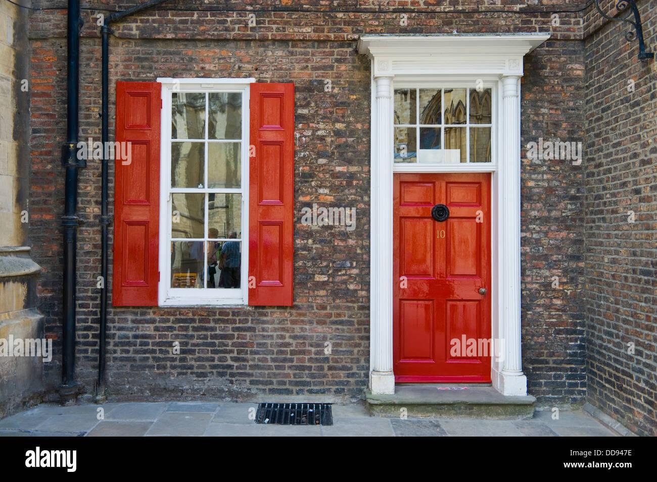 Red Front Door Georgian House With Red Front Door And Christmas Wreath Stock