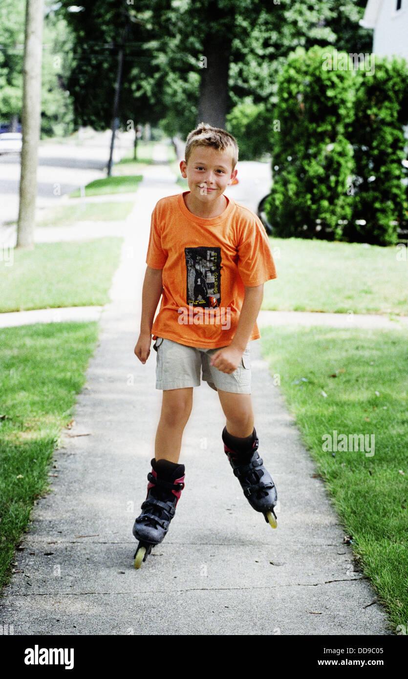 Roller skating quebec city - 8 Year Old Boy Roller Blades On A Residential Sidewalk Stock Image