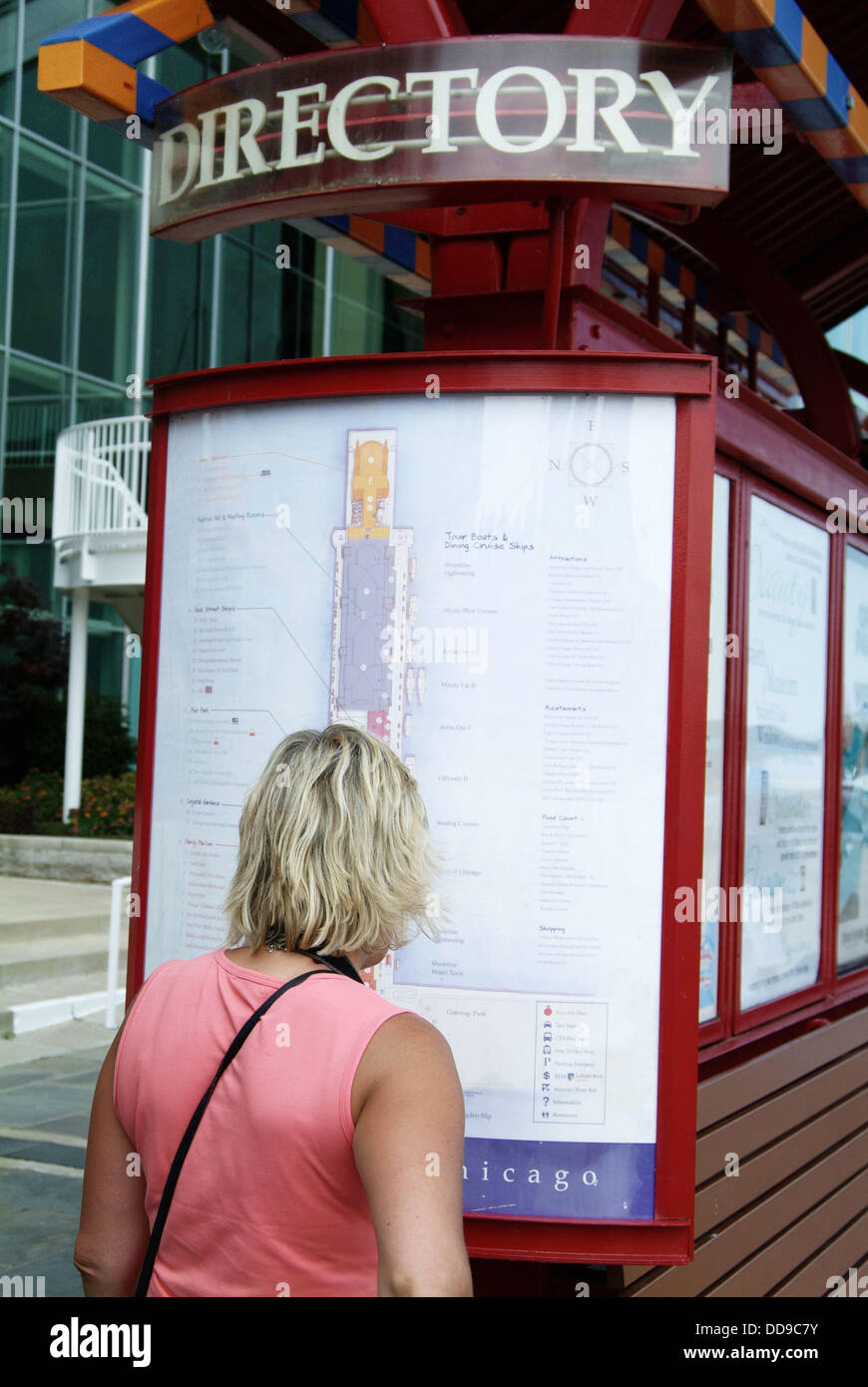 Adult Female Looks At The Directory And Map To The Navy Pier In - Chicago map navy pier