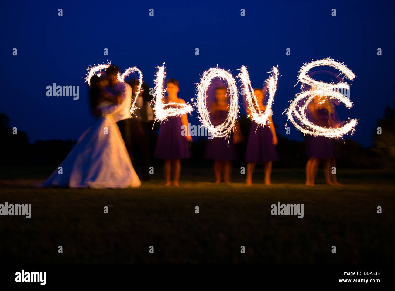 stock photo bride and groom in love on their wedding day sparklers used to spell the word love